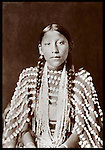Cheyenne girlwith Buckskin outfit decorated with 500 elk's teeth by HW Daly