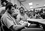 Modesto, California, May 18, 1971.While in Modesto to speak at the SOS Club, Muhammad Ali visited Modesto's black community at the King-Kennedy Community Center.  Sportsmen of Stanislaus Club invited Muhammad Ali to speak in Modesto.  In the past, the SOS Club had hosted other boxing greats such as Max Baer, Jack Dempsey, Joe Louis, Rocky Marciano and Joe Frazier. One month later in June of 1971, the Supreme Court ruled in favor of Ali on the issue of his draft evasion conviction, clearing the way for him to box and eventually regain his title.  SOS was a male-only organization at that time and charged $5.00 per dinner ticket..Photo By Al Golub/Golub Photography.