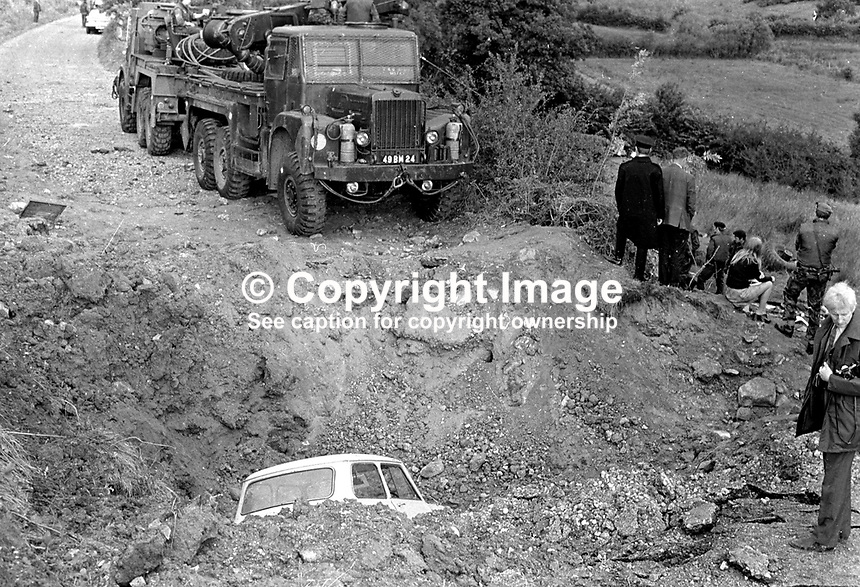 British Army engineers recover the Saracen armoured vehicle in which 3 soldiers died when a 400 to 500lb Provisional IRA landmine was detonated under it near Dungannon, Co Tyrone, N Ireland, on 10th Septermber 1972. The 3 soldiers who died were members of the Argyll &amp; Sutherland HIghlanders regiment. Five other soldiers were injured. A civilian, who shortly after the blast drove his Mini into the 25ft deep crater was only slightly hurt. <br /> <br /> Copyright Image from Victor Patterson, 54 Dorchester Park, Belfast, UK, BT9 6RJ<br /> <br /> t: +44 28 90661296<br /> m: +44 7802 353836<br /> vm: +44 20 88167153<br /> e1: victorpatterson@me.com<br /> e2: victorpatterson@gmail.com<br /> <br /> For my Terms and Conditions of Use go to www.victorpatterson.com