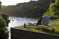 There are stunning views of the Fowey estuary from the flat grass roof of the house which is planted with both wild and ornamental grasses
