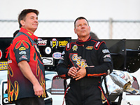 Feb 13, 2016; Pomona, CA, USA; NHRA funny car driver Jim Campbell with crew member Corey Lee during the Winternationals at Auto Club Raceway at Pomona. Mandatory Credit: Mark J. Rebilas-USA TODAY Sports