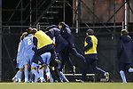 25 November 2012: UNC players pile on Cameron Brown after his game-winning goal. The University of North Carolina Tar Heels played the Farleigh Dickinson Knights at Fetzer Field in Chapel Hill, North Carolina in a 2012 NCAA Division I Men's Soccer Tournament third round game. UNC won the game 1-0 in overtime.