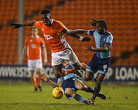 Wycombe Wanderers' Luke O'Nien sends Blackpool's Armand Gnanduillet sprawling<br /> <br /> Photographer Alex Dodd/CameraSport<br /> <br /> Checkatrade Trophy Round 3 Blackpool v Wycombe Wanderers - Tuesday 10th January 2017 - Bloomfield Road - Blackpool<br />  <br /> World Copyright &copy; 2017 CameraSport. All rights reserved. 43 Linden Ave. Countesthorpe. Leicester. England. LE8 5PG - Tel: +44 (0) 116 277 4147 - admin@camerasport.com - www.camerasport.com