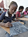 Angelene Pierre, 13,  and other children in Port-au-Prince participate in an art program sponsored by Viva Rio, a Brazilian nongovernmental organization whose work with survivors of the January 12 earthquake is supported by the ACT Alliance.
