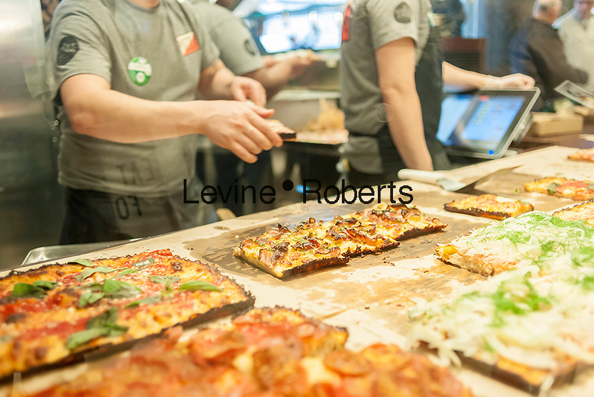 Detroit style pizza in the new Whole Foods Market opposite Bryant Park in New York on opening day Saturday, January 28, 2017. The store in Midtown Manhattan is the chain's 11th store to open in the city. The store has a large selection of prepared foods from a diverse group of vendors inside the store.  (© Richard B. Levine)