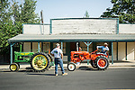 John Deere and Allis-Chalmers tractors prepare for the Amador County Fair opening parade in Plymouth, Calif.