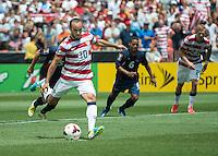 SANDY, UT - July 13, 2013: US Mens National Team forward Landon Donovan (10) shoots a penalty kick during the USA vs Cuba match at Rio Tinto Stadium in Sandy, Utah. Final score USA 4, Cuba 1.