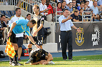 Philadelphia Union manager Peter Nowak looks for a card after a player was fouled. The Philadelphia Union defeated CD Chivas USA 3-0 during a Major League Soccer (MLS) match at PPL Park in Chester, PA, on September 25, 2010.