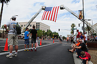 Phoenix, Arizona. July 7, 2013 - Nineteen hearses for each of the fallen members of the Granite Mountain Hotshots Arizona firefighting crew who died last week formed a procession to honor them in Phoenix as their bodies were taken back home to Prescott, about an 80-mile route. A few hundred Phoenix metro residents gathered along Washington Avenue to pay their respects to the firefighters as a procession with their bodies was set to depart toward the hometown where most of the deceased live in central Arizona. Photo by Eduardo Barraza © 2013