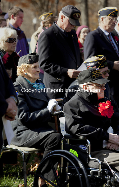 SOUTHBURY, CT-11 November 2013-111113BF03- Lee Ryan from Southbury, who served with the American Red Cross in Italy and France during WWII, middle,sits with other veterans during the Veterans Day ceremony at Veterans Memorial Park in Southbury Monday morning.  The event was hosted by Southbury's VFW Post 1607 and the Lt. C. Edward Hine American Legion Post 147. Bob Falcetti Republican-American