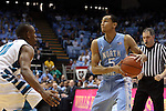 31 December 2013: North Carolina's Marcus Paige (5) and UNC Wilmington's Freddie Jackson (10). The University of North Carolina Tar Heels played the UNC Wilmington Seahawks at the Dean E. Smith Center in Chapel Hill, North Carolina in a 2013-14 NCAA Division I Men's Basketball game. UNC won the game 84-51.