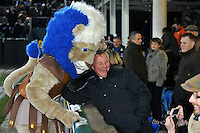 Bath Rugby mascot Maximus poses for a photo with a supporter at half-time. Aviva Premiership match, between Bath Rugby and Northampton Saints on December 5, 2015 at the Recreation Ground in Bath, England. Photo by: Patrick Khachfe / Onside Images