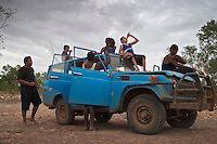 """Derek Counselor showed up with this bush truck full of kids (above) to go swimming.  I asked Counselor if he was afraid of the crocs that were just up river.  He said """"of course I am, why do you think I brought all these kids?""""  I had asked Carol's group that same question and they said of course we're afraid of crocs, there's a big one just up river... we've seen it... Carol and her friends had their dog, Baylor, in the water with them.  A dog is more than just a pet up here, it is a security blanket.  Crocs can not resist a dog.  If a dog is in a group of people swimming, it will be the first to go.  You see folks walking along rivers and even the ocean with their dogs... the dog gets them out the door to take a walk, but it also protects them."""