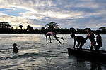 Children playing at sunset in the Salinas River in Santa Elena, Guatemala. On the other side of the river is Mexico.