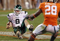 Oct 23, 2010; Charlottesville, VA, USA;  Eastern Michigan Eagles quarterback Alex Gillett (8) slides to safety in front of Virginia Cavaliers cornerback Devin Wallace (28) during the 2nd half of the game at Scott Stadium. Virginia won 48-21. Mandatory Credit: Andrew Shurtleff