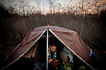 David Hernandez makes dinner in his tent at the SafeGround camp in Sacramento, Calif., January 14, 2011.