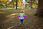 My older son, age five, heads to the playground with his $2.99 Salvation Army broken Buzz Lightyear wings, $.99 construction hat and a pair of archival print gloves.