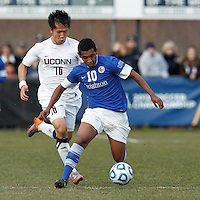 Creighton University midfielder Jose Gomez (10) on the attack as University of Connecticut defender Flo Liu (16) closes..NCAA Tournament. Creighton University (blue) defeated University of Connecticut (white), 1-0, at Morrone Stadium at University of Connecticut on December 2, 2012.