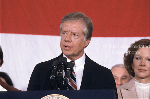United States President Jimmy Carter makes remarks conceding the election to Republican Ronald Reagan at the Sheraton Washington Hotel in Washington, DC on November 4, 1980.  First lady Rosalynn Carter is at right.<br /> Credit: Benjamin E. &quot;Gene&quot; Forte / CNP