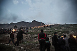 21/03/15 -- Akre, Iraq -- People start climbing on Mount Akre with lit up torches.