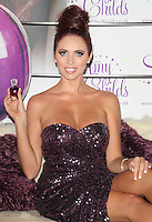 Amy Childs launches her debut fragrance - 'Amy Childs' with a photocall at Aura, St James, London, England..August 15th 2012.half length purple strapless dress sequins sequined sitting hair up slit split.CAP/ROS.©Steve Ross/Capital Pictures.