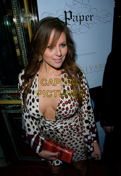 ABI TITMUSS.Attending the P Diddy Party at Paper nightclub,.London, England, March 27th 2007..half length white black and red polka dot wrap dress low cut cleavage.CAP/CAN.©Can Nguyen/Capital Pictures
