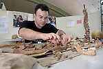 Yuri Defloran, a member of the forensic anthropology team of the Human Rights Office of the Archdiocese of Guatemala, examines human remains in the team's lab in Guatemala City. This team exhumes victims of the country's bloody civil war and compiles evidence about their killings, in an effort to help communities rebury their dead in appropriate fashion and begin a process of demanding justice for those responsible for the violence.