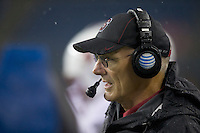 SEATTLE, WA - September 28, 2013: Stanford defensive line coach watches his team during play against Washington State at CenturyLink Field. Stanford won 55-17