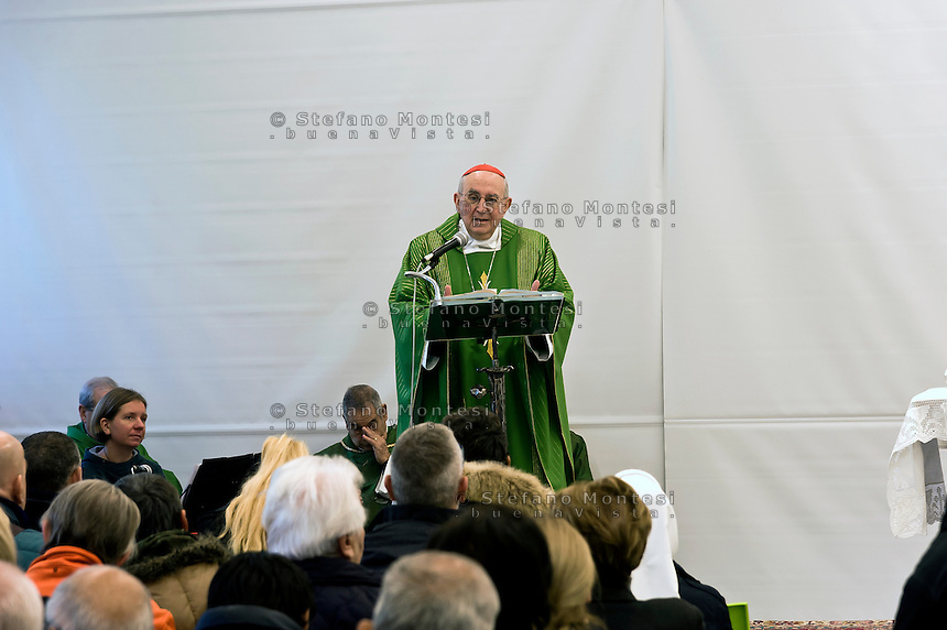"""ROME, ITALY - NOVEMBER 12:  Jubilee, closed Holy Door of Charity at Caritas hostel """"Don Luigi Di Liegro"""". Cardinal Pope's vicar for the Diocese of Rome, Agostino Vallin (ipictured) , has chaired this morning's Mass for the closing of the Holy Door of Charity on November 12, 2016 in Rome, Italy. Open December 18, 2015 by Pope Francis - the first in the history of Jubilees that does not introduce in basilicas, cathedrals and churches,  was crossed by over 12 thousand pilgrims. (Photo by Stefano Montesi/Corbis via Getty Images)"""