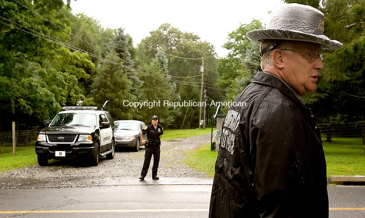 SEYMOUR, CT- 11 AUGUST 2008 --081108JS04-Lt. J. Paul Vance, a state police spokesman, speaks during a press conference in near 160 Bungay Road in Seymour as state officals, with help from the F.B.I. continue digging in the rear of the property as they investigate a tip on the disappearance of Billy Smolinski of Waterbury, who was last seen on August 24th, 2004. Officals have been excavating on the property since Friday.