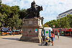 Statue with graffiti, at protest camp at Placa de Catalunya, Barcelona, Spain. Graffiti reads &quot;o los fusilles, o las cadenas&quot; - guns or chains. The square has been relatively quiet since police attacked and beat protestors on May 27 2011.