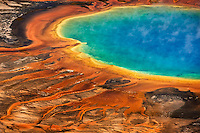 Grand Prismatic Spring, Midway Geyser Basin, Yellowstone National Park, Wyoming, USA on a sunny day shows off its amazing colors due to the mineral and thermophilic bacteria content.