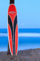 Red and black surf board at Avon pier near twilight on Hatteras Island.