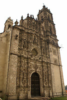 The baroque facade of the 1th century Iglesia de San Francisco in Tepotzotlan, Mexico.  The San Francisco Javier Church and adjoining former Jesuit monastery now house the National Museum of the Viceroyalty or Museo Nacional de Virreinato.