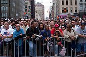 New  York, New York.September 11, 2011..Crowds gather at Church Street and Barclay Street to get close to Ground Zero to mark the 10th anniversary of 9-11-2001 tragic attack on the US. The entire area was under extremely heave police presents during the day. Visitors listen as the names of the more then three thousand victims, who died on that day, are read.