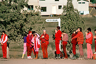 Wasco, Oregon, February 1984: Disciples of Bhagwan Rajneesh, wait in line along the roads of Rajneeshpuram to greet him during  his daily trip through the community in his Rolls-Roys. Rajneeshpuram, was an intentional community in Wasco County, Oregon, briefly incorporated as a city in the 1980s, which was populated with followers of the spiritual teacher Osho, then known as Bhagwan Shree Rajneesh. The community was developed by turning a ranch from an empty rural property into a city complete with typical urban infrastructure, with population of about 7000 followers.