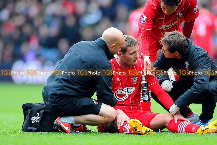 Jos Hooiveld of Southampton gets treatment before going off in the first half - Southampton vs Liverpool - Barclays Premier League Football at St Marys Stadium, Southampton, Hampshire - 16/03/13 - MANDATORY CREDIT: Denis Murphy/TGSPHOTO - Self billing applies where appropriate - 0845 094 6026 - contact@tgsphoto.co.uk - NO UNPAID USE.