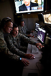From left, Captain John Durkee, Staff Sergeant Justin Randall, and Tech Sergeant Time Anderson work on the operations floor at Beale Air Force Base in Linda, Calif., April 30, 2010.