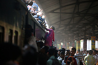 Homebound Bangladeshi Train and Ferry People