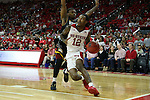 27 November 2015: NC State's Anthony (Cat) Barber (12) moves past Winthrop's Keon Johnson (behind). The North Carolina State University of North Carolina Wolfpack hosted the Winthrop University Eagles at the PNC Arena in Raleigh, North Carolina in a 2015-16 NCAA Division I Men's Basketball game. NC State won the game 87-79.