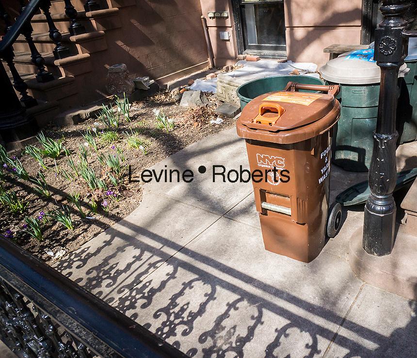 Bin for the New York Dept. of Sanitation  Organic Waste Collection program in the Carroll Gardens neighborhood of New York on Saturday, March 12, 2016 .  (© Richard B. Levine)