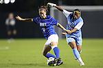 18 October 2012: Duke's Cassie Pecht (11) and UNC's Meg Morris (32). The University of North Carolina Tar Heels defeated the Duke University Blue Devils 2-0 at Koskinen Stadium in Durham, North Carolina in a 2012 NCAA Division I Women's Soccer game.