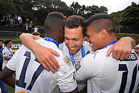Auckland captain Angel Berlanga is hugged by teammates after winning the Oceania Football Championship final (second leg) football match between Team Wellington and Auckland City FC at David Farrington Park in Wellington, New Zealand on Sunday, 7 May 2017. Photo: Dave Lintott / lintottphoto.co.nz