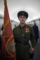 Moscow, Russia, 01/05/2010..A young man in Soviet era army uniform waits in a metro station for the start of a Communist demonstration central Moscow. A variety of political groups took to the streets on the traditional Russian Mayday holiday.