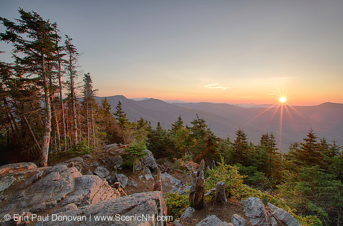August 2014 - Sunrise from the summit of Mount Tecumseh in Waterville Valley, New Hampshire during the month of August. Illegal tree cutting has improved the view from this summit. Forest Service has stated that the ones doing the cutting will be held accountable if caught.