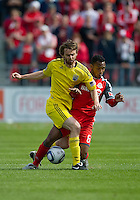 23 April 2011: Columbus Crew midfielder/forward Eddie Gaven #12 and Toronto FC midfielder Julian de Guzman #6  in action during an MLS game between the Columbus Crew and the Toronto FC at BMO Field in Toronto, Ontario Canada..The game ended in a 1-1 draw.
