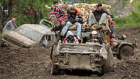 A 'modified' car rides into the mud pit during the second day of festivity of the 2006 annual Victoria Day Weekend at Trudeau Park in Tweed, Ontario