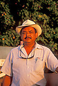 Puerto Rican man with hat at sunset; Guanica, Puerto Rico.