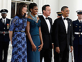 (L-R) Samantha Cameron, First lady Michelle Obama, British Prime Minister David Cameron and U.S. President Barack Obama pose for photographs on the North Portico of the White House March 14, 2012 in Washington, DC. Cameron is on a three-day visit to the U.S. and he was expected to have talks with Obama on the situations in Afghanistan, Syria and Iran.  .Credit: Chip Somodevilla / Pool via CNP