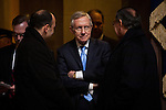 Senate majority leader Harry Reid of Nevada, center, talks to Secretary of Defense Leon Panetta in the US Capitol Rotunda on their way to the inaugural luncheon, January 21, 2013 in Washington, DC.